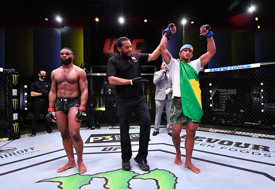 LAS VEGAS, NEVADA - MAY 30: Gilbert Burns of Brazil reacts after his victory over Tyron Woodley in their welterweight fight during the UFC Fight Night event at UFC APEX on May 30, 2020 in Las Vegas, Nevada. (Photo by Jeff Bottari/Zuffa LLC)